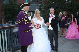 Town Crier with bride and groom